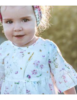 Falbaniasta sukienka z nadrukiem łączki